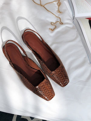 Brown sling with low heel shoes