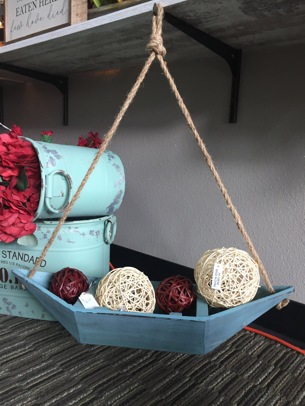 Blue wooden rowboat decor with rope hanger