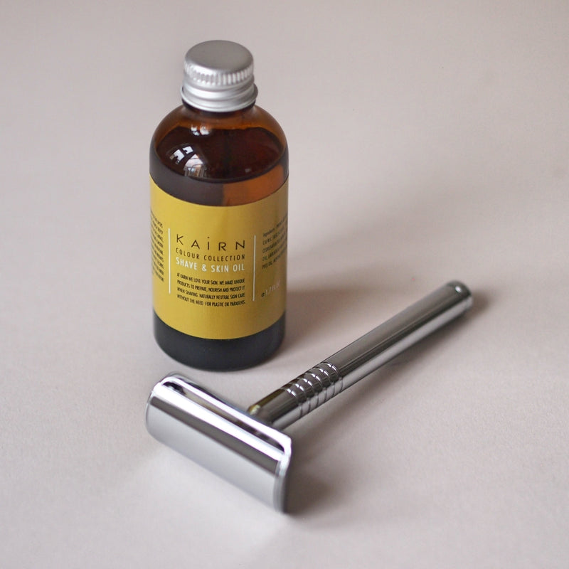Metal razor and shave oil