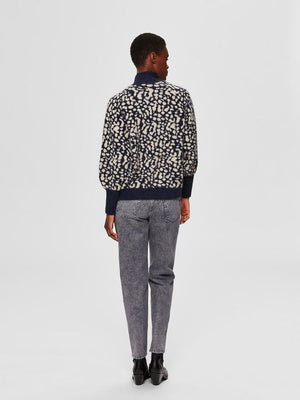 Selected Femme animal print Paris jumper. Knitted pullover with print design. Shown on model, paired with jeans and viewed from back.