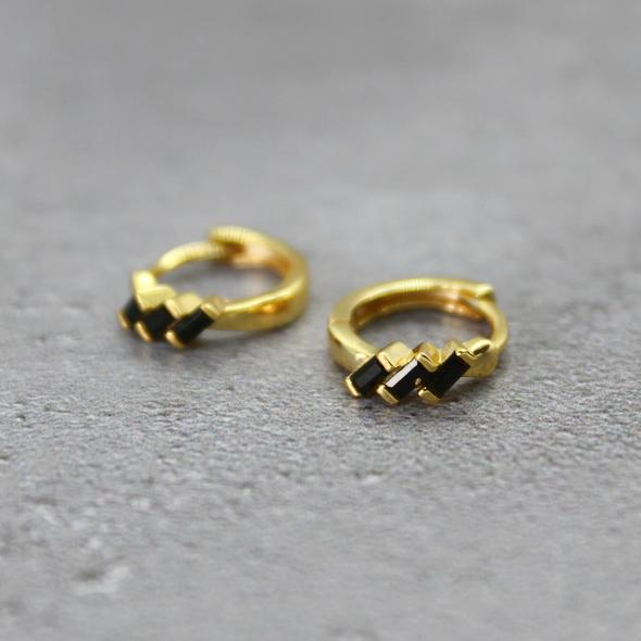 Mara Studio black cubic zirconia huggies. Gold plated hoop earrings for layering. Available from Mint Tea Boutique