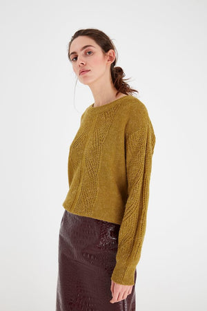 Mustard yellow women's knitted jumper. Lng sleeves, casual fit. View from front, worn by model and paired with maroon skirt. Mint Tea Boutique