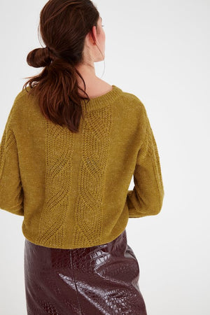 Mustard yellow women's knitted jumper. Lng sleeves, casual fit. View from back, worn by model and paired with maroon skirt. Mint Tea Boutique