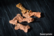 Dehydrated sweet potato treats shaped as dog bones