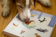 Dog examining advent calendar for treats