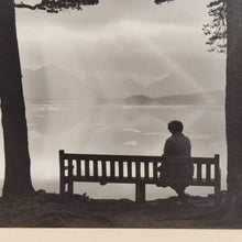 Load image into Gallery viewer, Vintage Original Photograph of a Lady sat by a Lake by Photographer Ian Reeves Titled 'Sunset Silhouette'