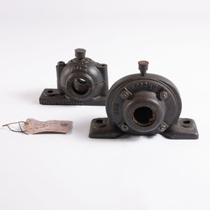 Two 1920s Cast Metal Bearings