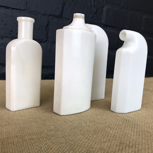 Set of Four Early Milk Glass Medicine Bottles