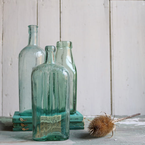 Three Reclaimed Vintage Glass Bottles
