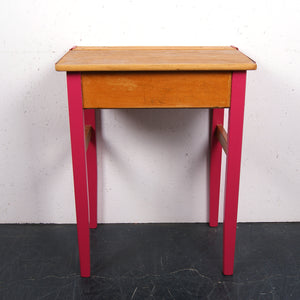 Children's wooden school desk with pink hinges and legs