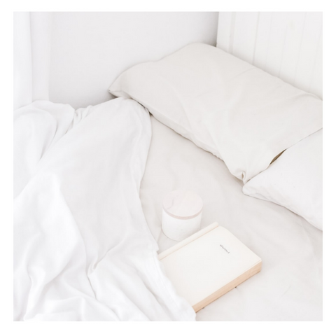 clean white bed with blanket and bedding