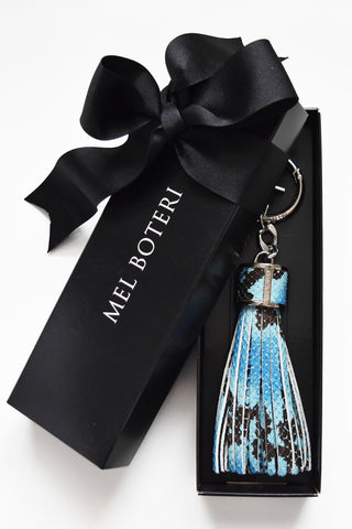 Mel Boteri | Blue Snake-Print Leather Tassel Bag and Key Charm | Model