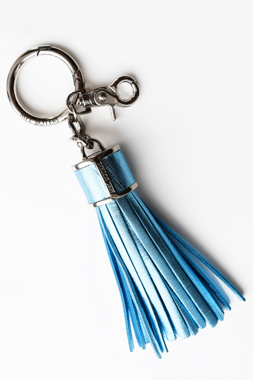 Mel Boteri | Metallic Blue Leather Tassel Bag and Key Charm | Front