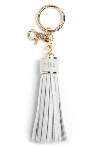 The Mel Boteri Pebbled-Leather Tassel Charm | White Pebbled Leather With Gold Hardware | Mel Boteri Gift Ideas