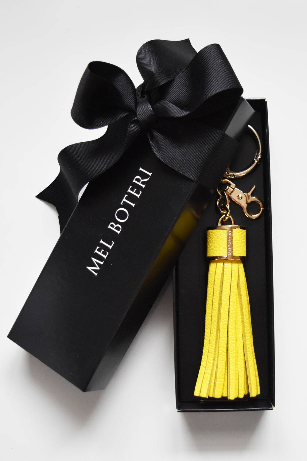 Mel Boteri | Yellow Pebble-Grain Leather Tassel Bag and Key Charm | Gold Hardware | Model