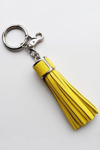 Mel Boteri | Yellow Pebble-Grain Leather Tassel Bag and Key Charm | Silver Hardware | Front