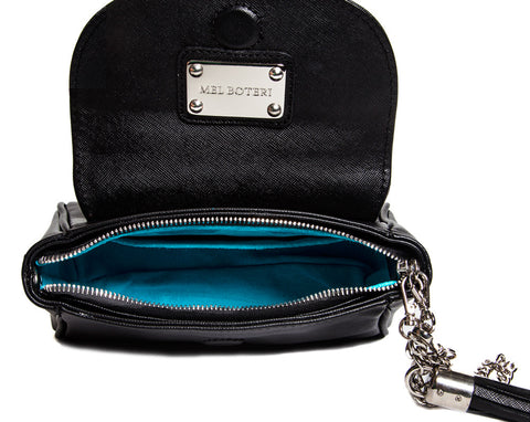handmade handbag with luxe turquoise suede lining