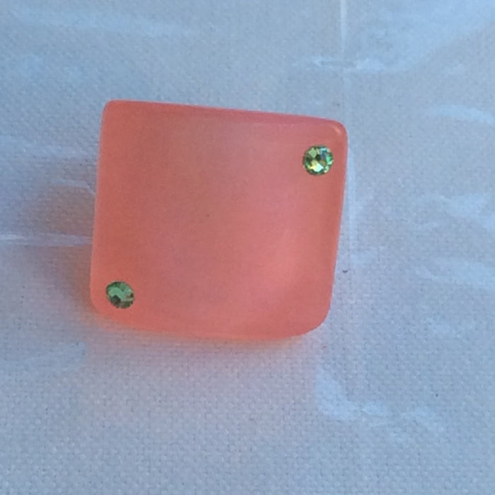 Simply stated pink resin ring
