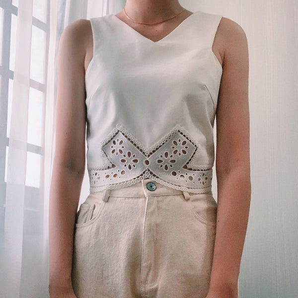The Closet Lover's white lasercut top