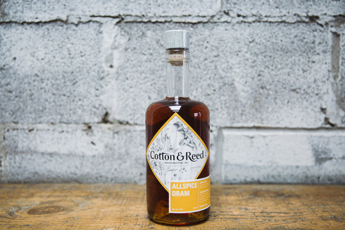 Bottle of Cotton & Reed Allspice Dram on bar counter
