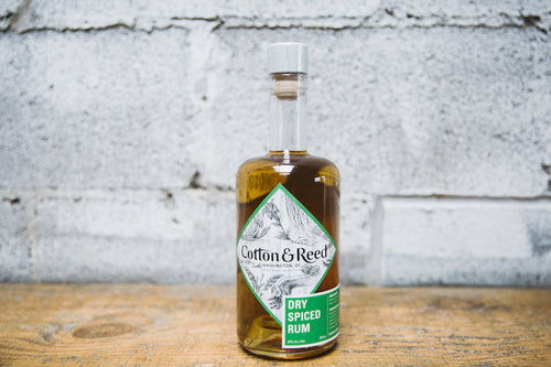 Bottle of Cotton & Reed Dry Spiced Rum on bar counter