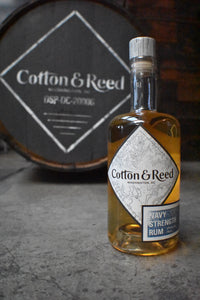 Bottle of Cotton & Reed rum on bar counter