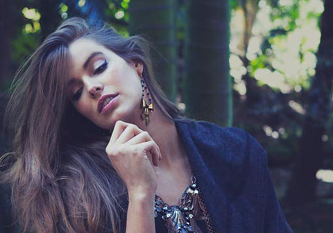 Robyn Lawley wears Ghost and lola's Beau Brummel Earrings of Vintage bows and rosary