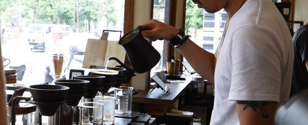 KINTO Journal Article Barista using POUR OVER KETTLE to brew coffee