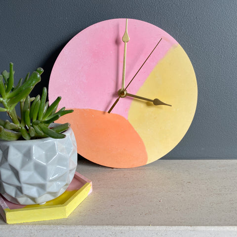 Pink, peach and Yellow Concrete Clock