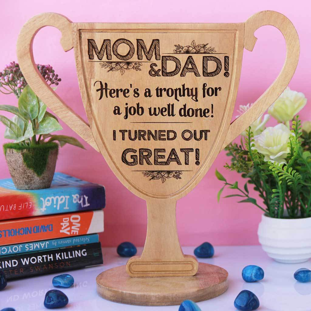 Mom & Dad! Here's a trophy for a job well done. I turned out great! Wooden Trophy Cup - This funny award for family is one of the best gifts for parents. Wooden Trophies & Awards make great gifts for mom and dad.