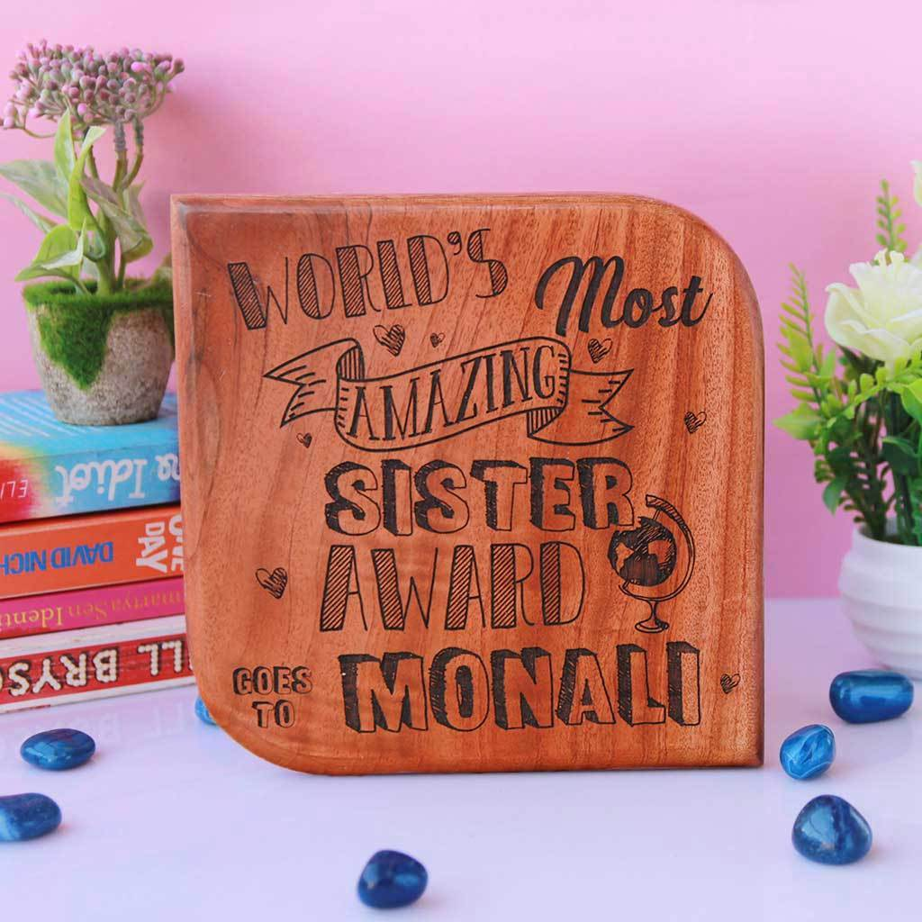 World's Most Amazing Sister Award. This Wooden Trophy makes great gifts for sister. Custom trophies engraved with name makes a good birthday gift for sister. This Custom Award is a Funny Gift for an amazing Sister.