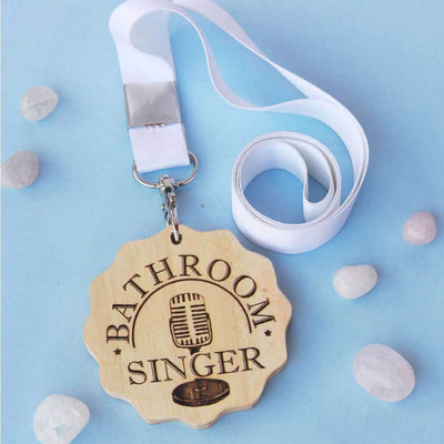 Bathroom Singer Engraved Medal. A funny award that makes great presents for friends. These wooden medals are funny gift ideas for brothers and sisters.