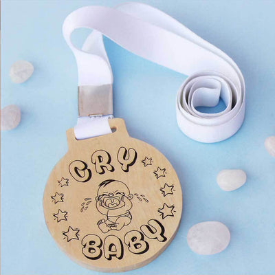 Cry Baby Wooden Medal With Ribbon. This funny medal is the best gift for a sentimental friend, colleague, brother or sister.
