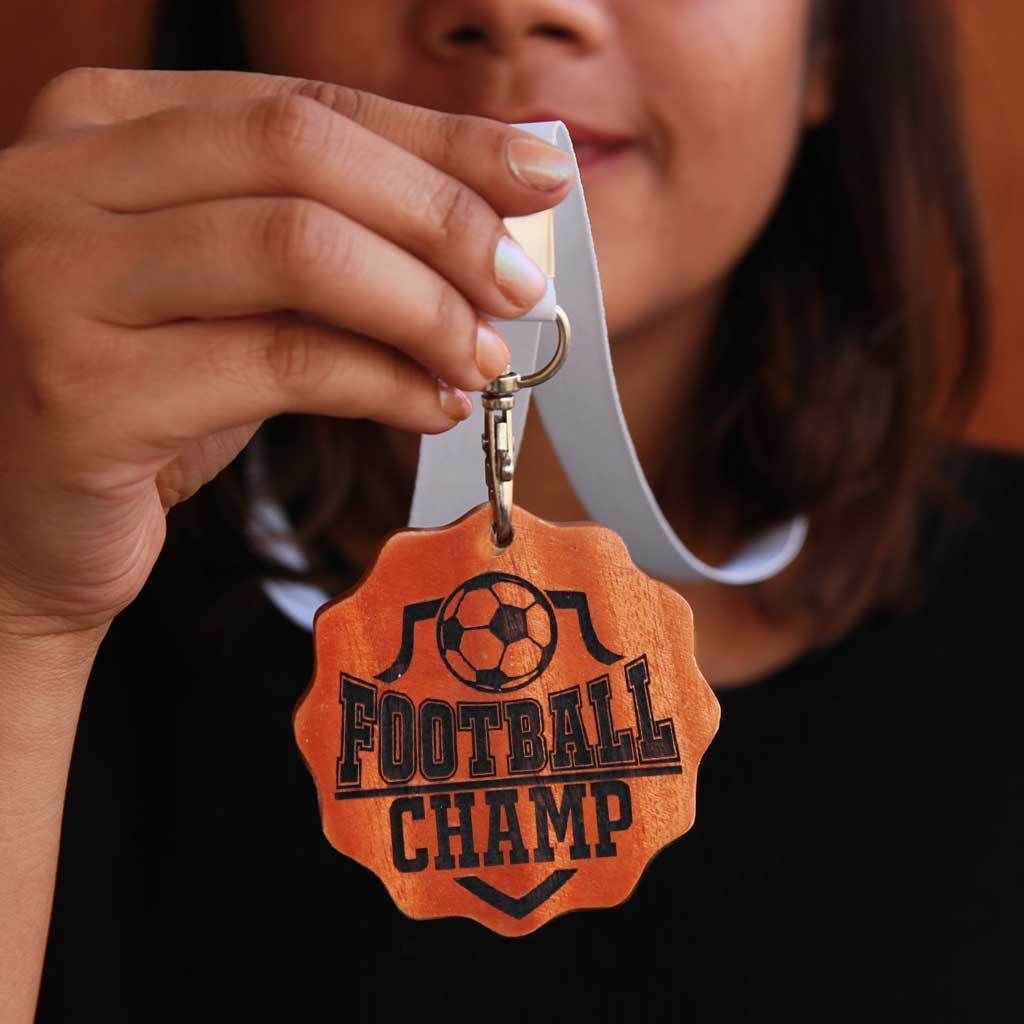 Football Champ Engraved Medal. Football Medal For The Best Footballer. These Unique Custom Medals Make One Of The Best Gifts For Football Fans. Buy More Sports Medals Online From The Woodgeek Store.