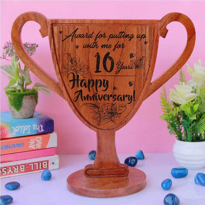 Happy Anniversary Wooden Trophy Cup For Putting Up With Me. Custom trophies are the best anniversary gift for husband or wife. A funny award for your partner for tolerating you.