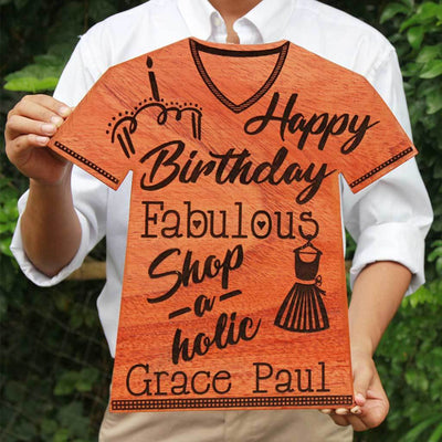 Happy Birthday Fabulous Shopaholic Wooden Plaque In The Shape Of A T-shirt. This Personalized Award Trophy Makes One Of The Best Gifts For Shopaholics - Looking For Unique Birthday Gifts ? Shop The Best Gifts For Loved Ones From The Woodgeek Store.