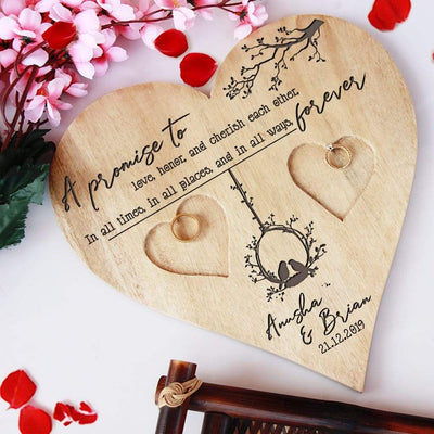 A Wooden Heart Shaped Ring Holder Engraved With Wedding Vow: A promise to love, honor, and cherish each other, in all times, in all places, and in all ways, forever. This Personalised Ring Tray Is Engraved With Couple Names & Wedding Date. This wedding ring holder is one of the best wedding gifts or engagement gifts for couples.
