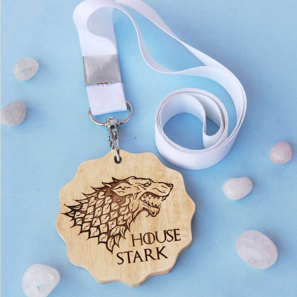 House Stark Engraved Medal. A unique award that makes great gifts for game of thrones fans. Buy House Stark sigil engraved custom medals online from The Woodgeek Store.