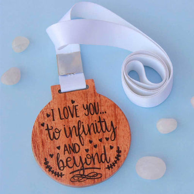 I Love You To Infinity and Beyond Wooden Medal. This Custom Medal Is One Of The Most Romantic Gifts For Girlfriend or Boyfriend. These Trophy Medals And Trophies Also Make Amazing Valentine's Day Gifts.