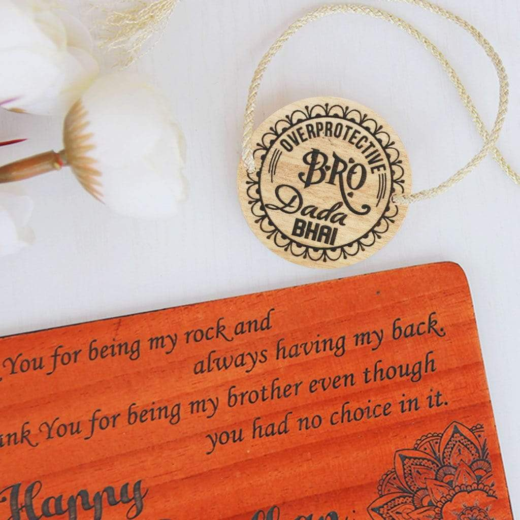 Overprotective Bro Personalized Rakhi for Brother & Raksha Bandhan Greeting Card - This Wooden Fancy Rakhi Can be Personalized With A Name - This Customized Rakhi Also Comes With A Wooden Rakhi Card Engraved With Raksha Bandhan Greetings - Buy Beautiful Rakhi Online And Personalized Rakhi Gifts For Brother Or Sister From The Woodgeek Store.