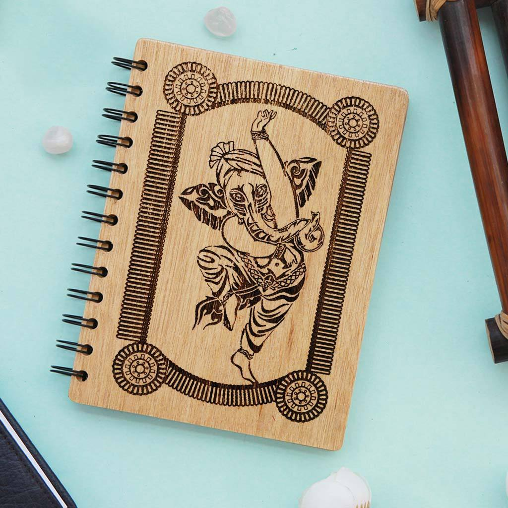 The Dancing Ganesh Personalized Wooden Notebook. This Spiral Notebook Makes The Best Ganesh Chaturthi Gifts. This Ganesha Gift Can Be Engraved With Happy Ganesh Chaturthi Wishes For Friends And Family.