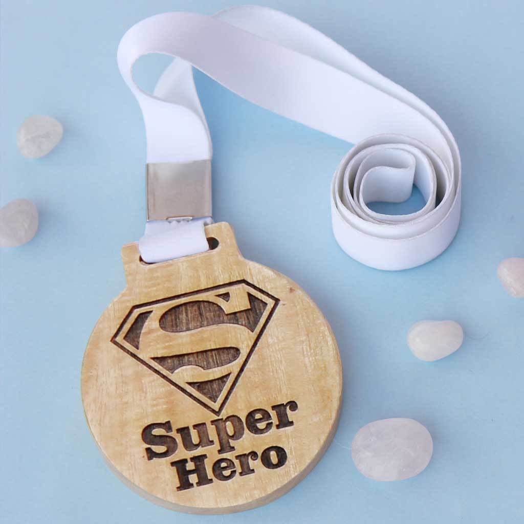 Superhero Wooden Medal With Ribbon. This Custom Medal Is The Best Gift For Dad, Mom, Brother Or Sister. A Great Appreciation Award For The Super Hero Of Your Life. Buy Medals Online From The Woodgeek Store.