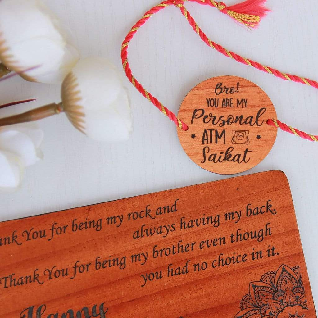 Bro You're My Personal ATM Wooden Rakhi & Greeting Card. This Personalised Rakhi can be customised with a name. The wooden Rakhi card can be engraved with Raksha Bandhan greetings. Buy Rakhi Online & Send Rakhi Online with Woodgeek Store