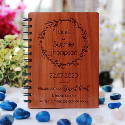A personalised wedding guest book engraved with names and a message for wedding guests asking them to sign your wedding guest book and leave a note, wishes or marriage advice. This wood bound notebook makes a great wedding guest book. This is the best wedding journal.