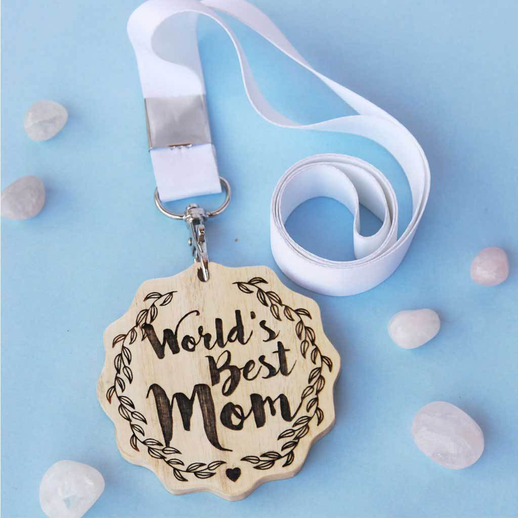 World's Best Mom Engraved Medal. It Is The Best Birthday Gift For Mom Or Mother's Day Gift. Buy More Customised Gifts For Parents From The Woodgeek Store.