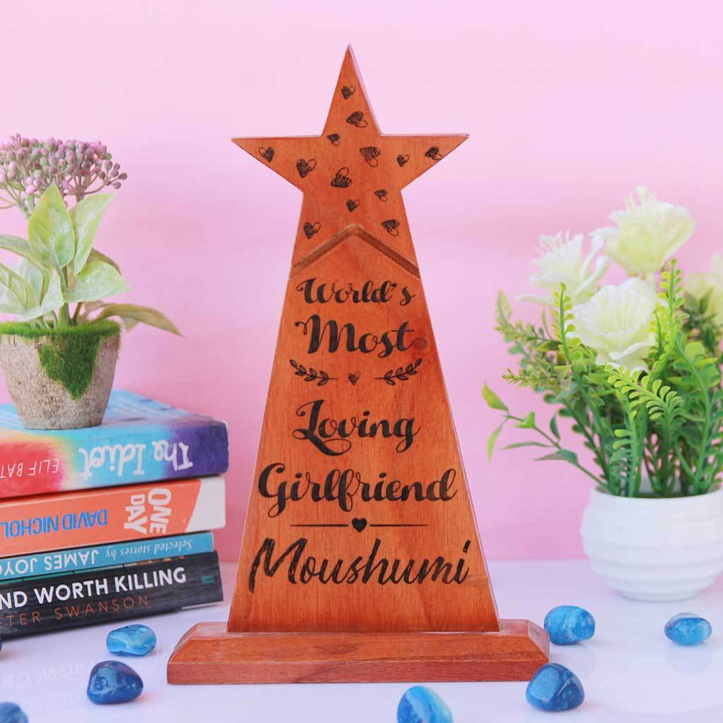 World's Most Loving Girlfriend Star Trophy. This Wooden Award makes a unique gift for girlfriend. These custom trophies are one of the best romantic gifts for her, anniversary gift or birthday gift for girlfriend.
