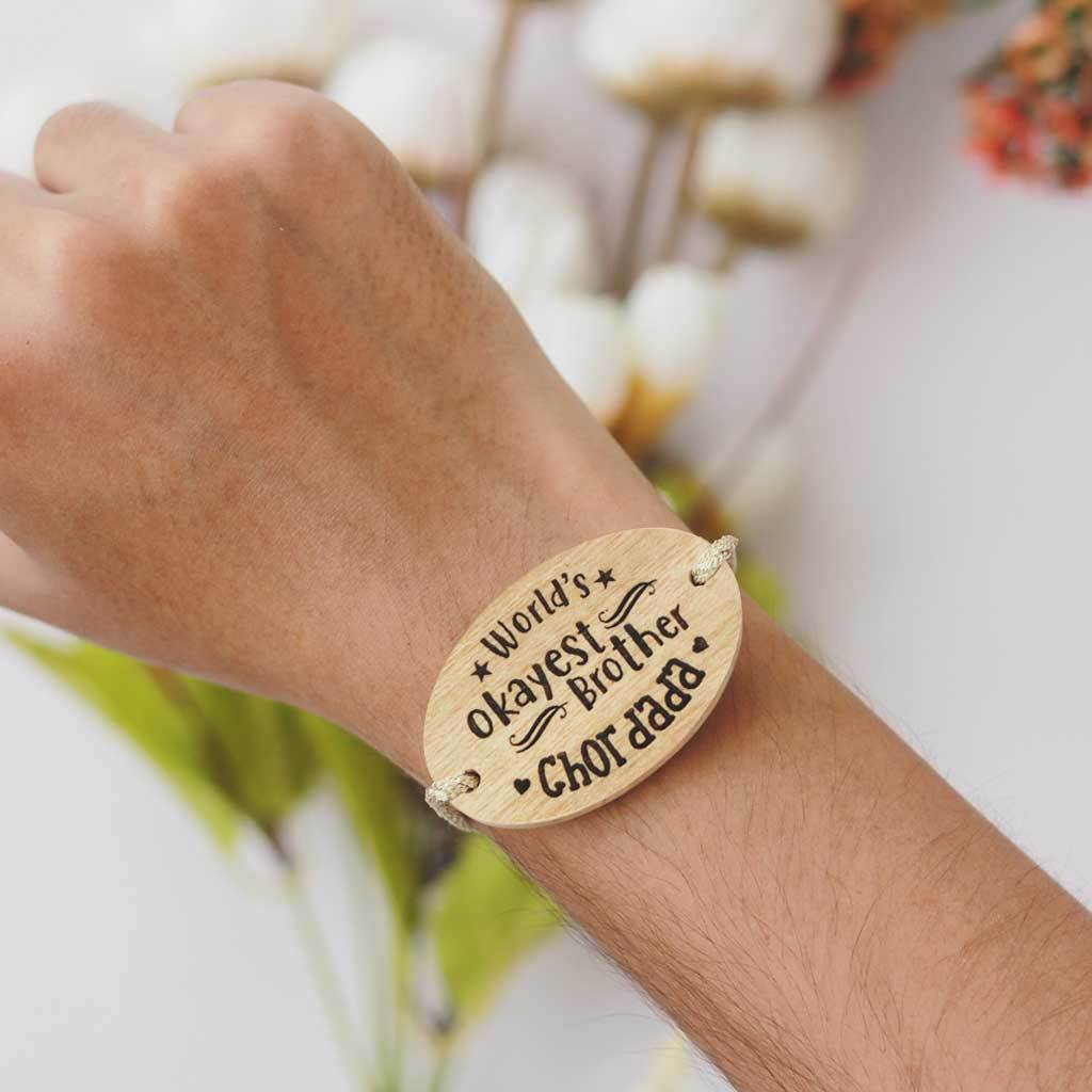 World's Okayest Brother Personalised Rakhi With Name. This Wooden Rakhi Is The Best Raksha Bandhan Gifts for Brother. Buy Rakhi Online India And Wish Your Brother a Happy Rakhi With Personalized Gifts From The Woodgeek Store.