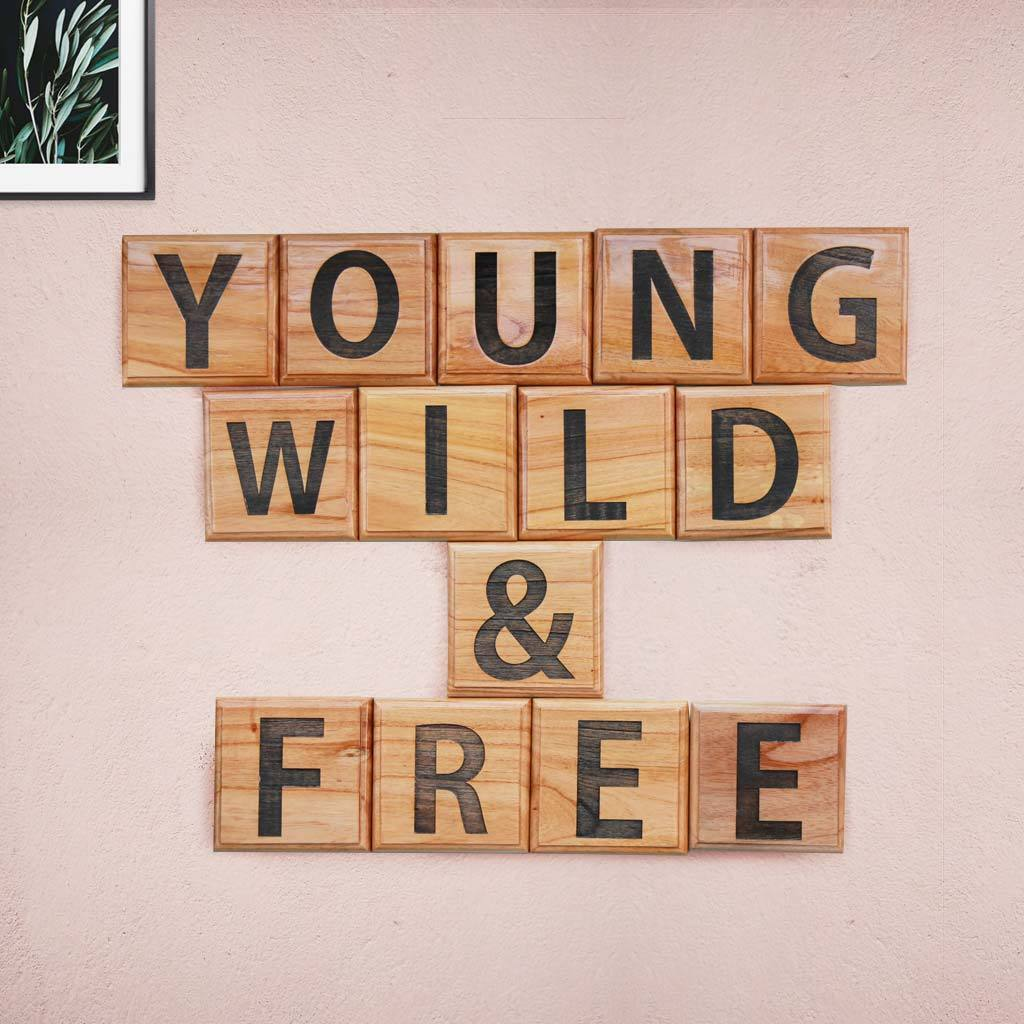 Young, Wild & Free Wooden Crossword Blocks. These Unique Crossword & Scrabble Wall Art Make Great Gifts For Youngsters And Amazing Wall Decor.