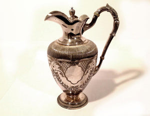 Ornate Silver Pitcher