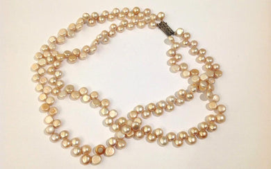 Natural button freshwater pearls in cream/pink strung on silk